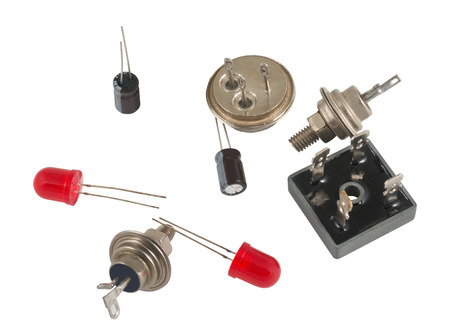 Powerful semi-conductor diodes and other radio components on a white background Stock Photo