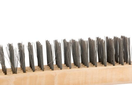 burnish: Wire brush with wooden handle on white background