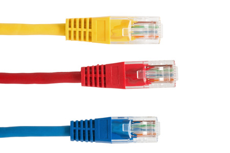 Four Multi Colored Network Cables on the white  background Фото со стока