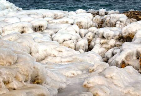 seacoast: Stones under snow and ice on seacoast