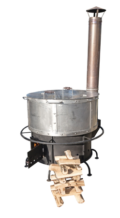 stove pipe: A new cast iron wood stove burning hot on a white background
