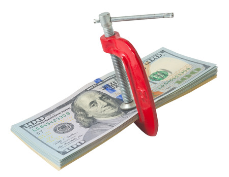 indebt: Dollar bills  are in an C clamps