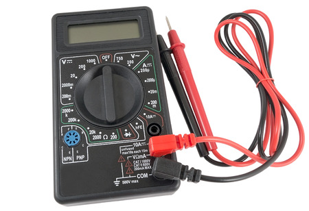 conductivity: Black color digital multimeter isolated on white background