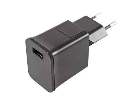 ac: AC adapter for charging the phone on a white background