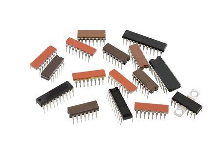 transistor: chips electrónicos aislados sobre fondo blanco Foto de archivo
