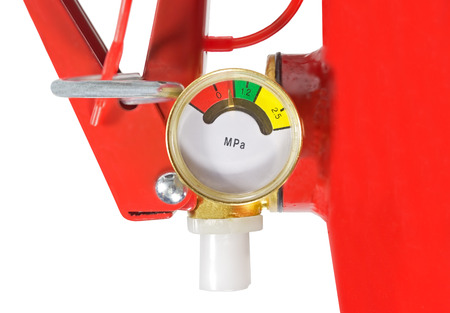 compressed air hose: Top of red fire extinguisher on white background