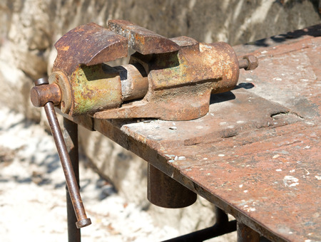 vise: old rusty vise on a metal table Stock Photo