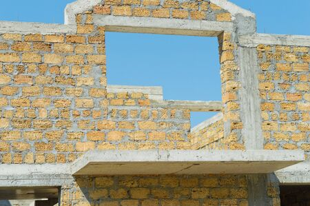 yellow stone: Building under construction from yellow stone