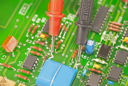 probes: multimeter test probes on printed circuit board Stock Photo