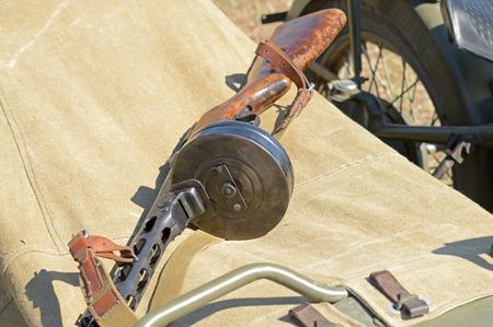 the silencer: old Soviet Machine gun on background canvas