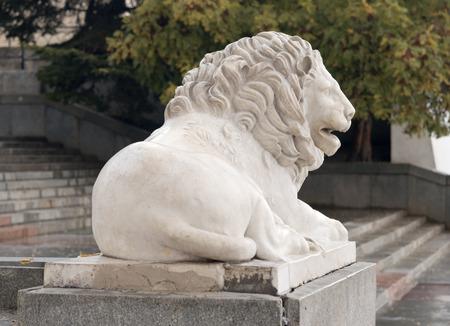 Marble Sculpture of a lion on pedestal