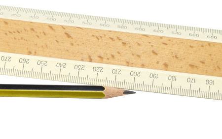Ruler and pencil closeup on a white background