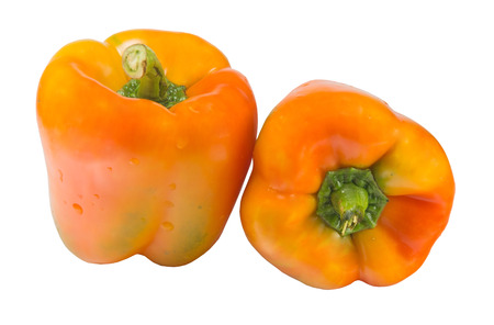 Two yellow pepper isolated on a white background