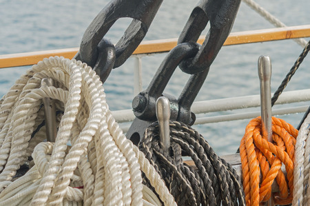 intertwined: Reeled ship ropes hanging on the spools Stock Photo