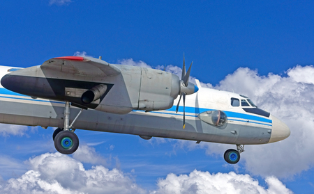 the old turboprop airplane on sky background