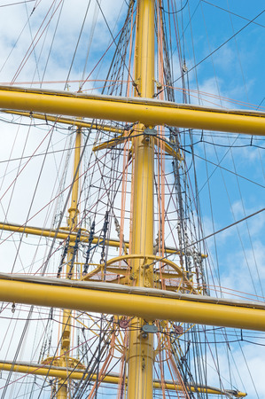 Masts and rigging of a sailing ship against blue sky and clouds Stock Photo