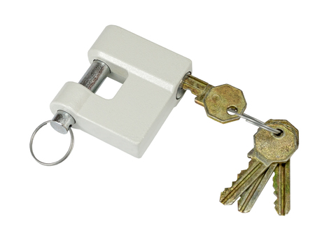 New close metal padlock with keys isolated on white background Stock Photo