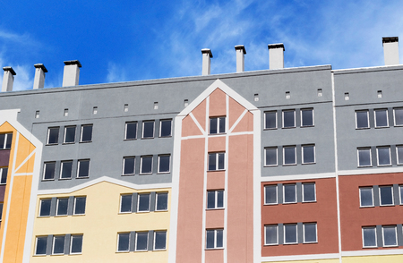 executive apartment: Modern, new executive apartment building on background of blue sky Stock Photo