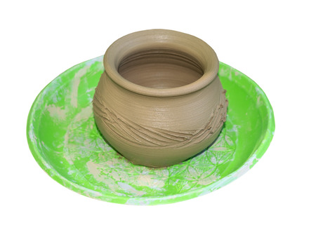 Clay mug on white background