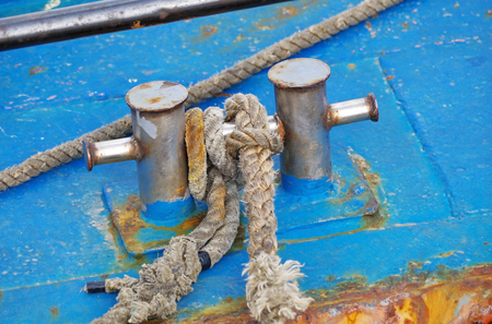 Bollard with rope abovedeck old ship Stock Photo