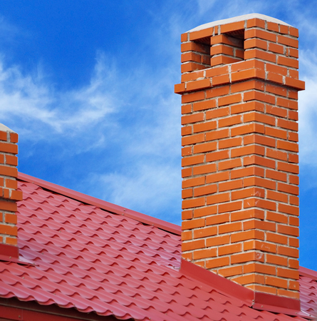 house from a red brick with a pipe on background sky
