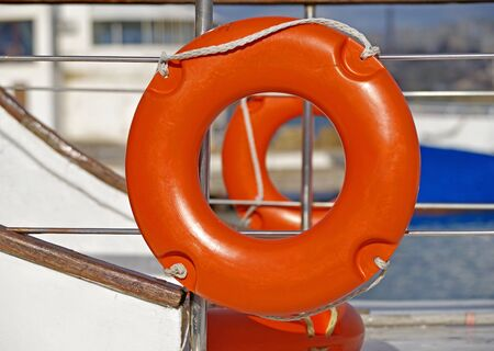 Orange lifebuoy attached to board the ship Stock Photo