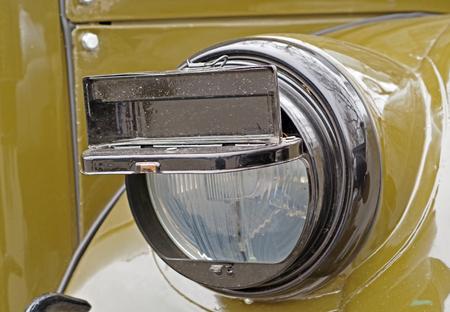 変装クローズアップと軍用車のヘッドライト 写真素材