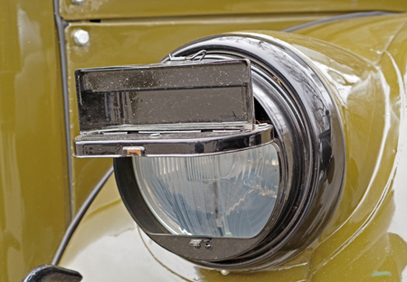 military car headlight with disguise closeup 写真素材