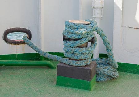 big Bollard with rope abovedeck ship