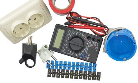Multimeter, electric socket, insulation tape, electrical transformers tester on a white background