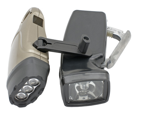 Led flashlights with manual recharging on white background