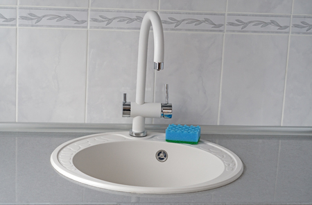 sink and water faucet in new modern kitchen interior 版權商用圖片