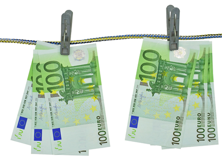 Euro notes on clothesline on white background