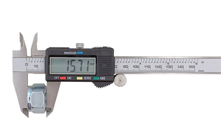 Measuring big steel nut with vernier calipers on white background Stock Photo