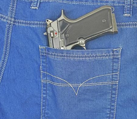 handgun  in new blue jeans pocket