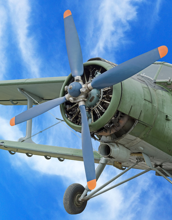 engine of classic airplane on background of blue sky