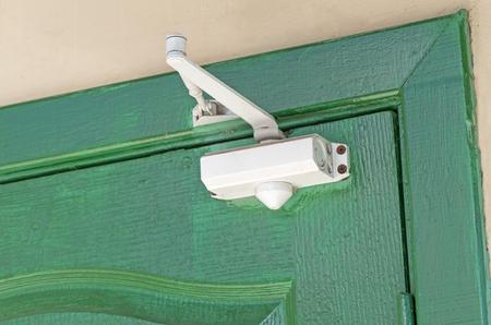 door closer mechanism on wooden door