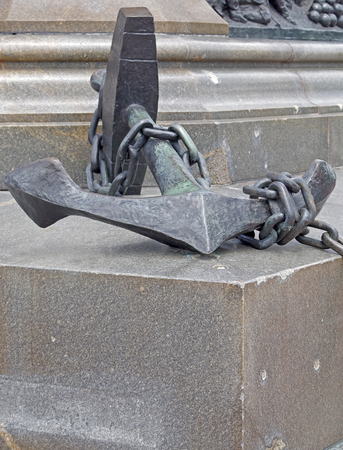 Old ship anchor on granite monument Stock Photo - 106145685
