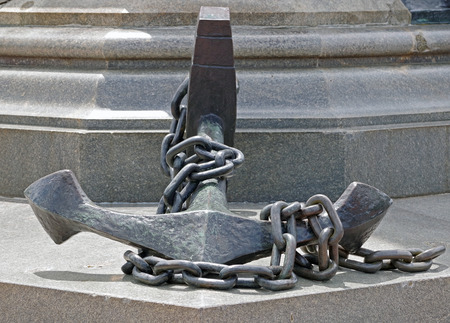 Old ship anchor on granite monument