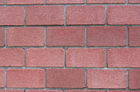 Square maroon brick wall as background