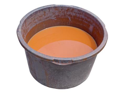 basin with orange liquid on White Background
