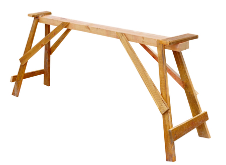 wooden device sawhorse for cutting stack of wooden logs on white background