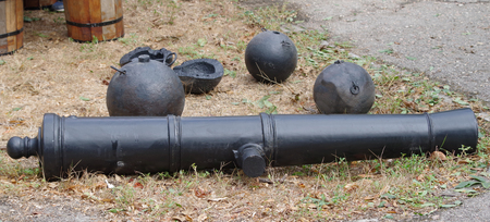 old barrel of the cannon and cannonballs