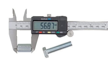 Measuring big steel nut with vernier calipers on white background Reklamní fotografie
