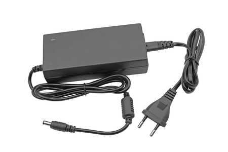 AC adapter on white background Standard-Bild