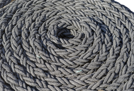 Coiled rope on a the deck of the sailboat