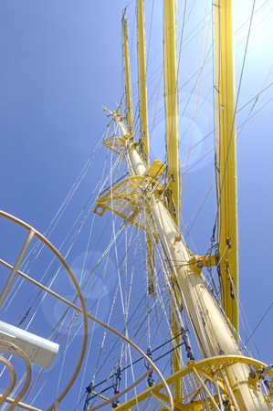 Masts and rigging of a sailing ship against blue sky and clouds Standard-Bild