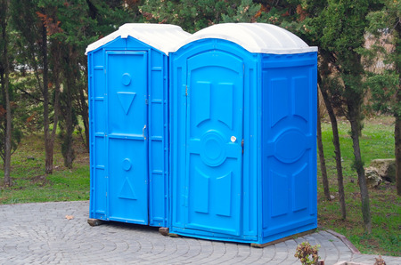 two blue biotoilet in the recreation area