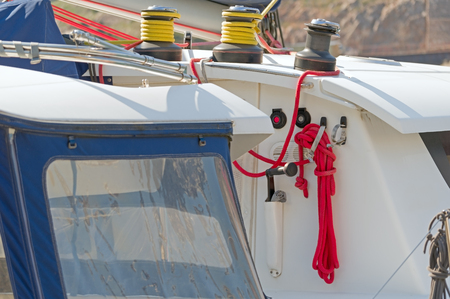 metallic pulley block and ropes on the deck of an sailboat ship Stok Fotoğraf