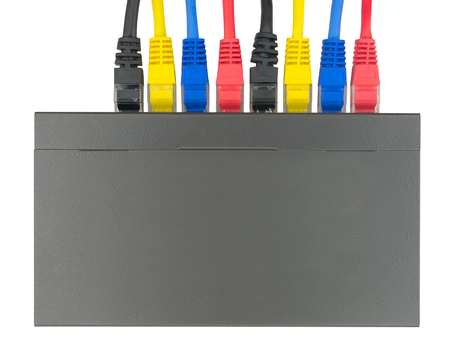 Multicolored network cables connected to router on a white background Foto de archivo